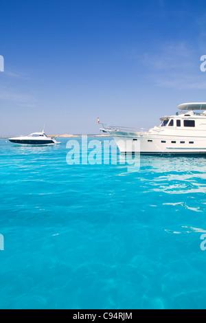 Luxury yatch in turquoise beach of Formentera Illetes - Stock Photo