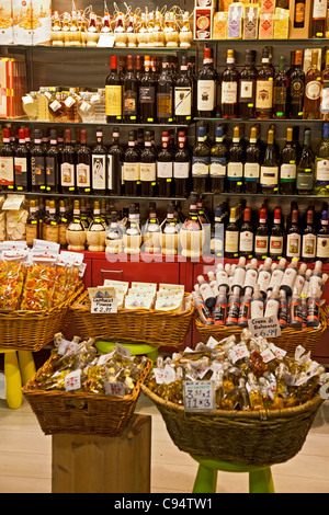 Food and wine for sale at the Mercato Centrale in Florence, Italy: coffee, wine, pasta, Cantucci, Crema di Balsamico - Stock Photo