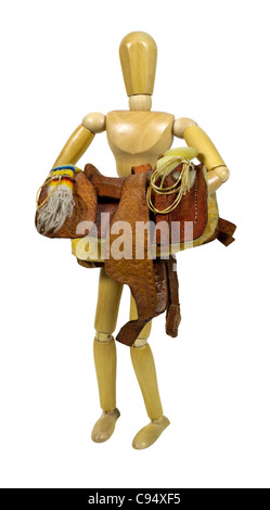 Carrying a western saddle made of heavy tan leather for riding domestic horses - path included - Stock Photo