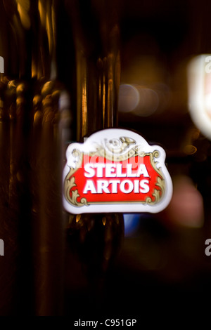Logo of beer Stella Artois in bar. - Stock Photo