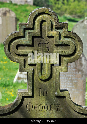 Detail of gravestone with cross motif. Church of Saint Michael, Lowther, Cumbria, England, United Kingdom, Europe. - Stock Photo