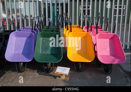 Countrywide Stores, Presteigne. Plastic wheelbarrows - Stock Photo