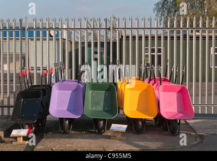 Countrywide Stores, Presteigne. Plastic wheelbarrows - Stock Photo