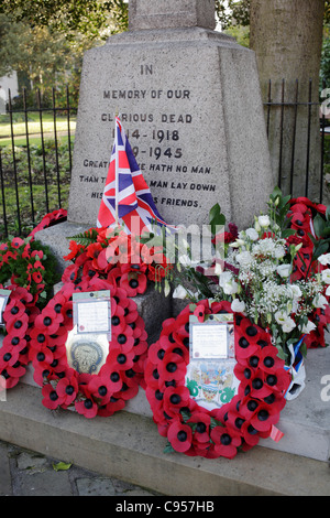 A war memorial with wreaths around it on remembrance Sunday - Stock Photo