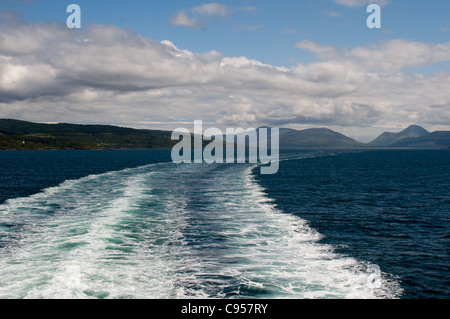 The wake of Caledonian MacBrayne ferry MV Clansman she sails into open water on a voyage between Oban and Castlebay. - Stock Photo