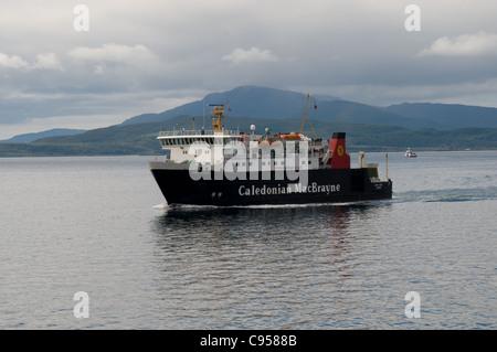 The Caledonian MacBrayne ferry MV Isle of Mull sails towards Oban , Scotland - Stock Photo