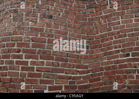 A warped looking brick wall. - Stock Photo