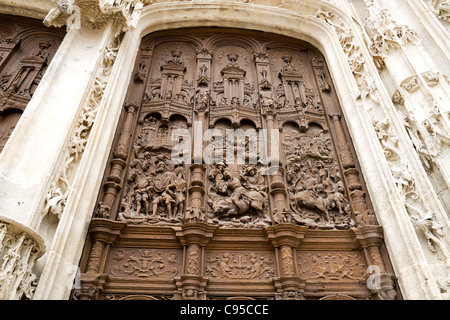 Large carved wooden door in the Gothic Cathedral of St Peter in the town of Beauvais France - Stock Photo