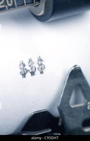 Typewriter close up shot, concept of making money - Stock Photo