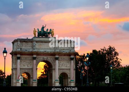 Arc de Triomphe du Carrousel at sunset, Paris France - Stock Photo