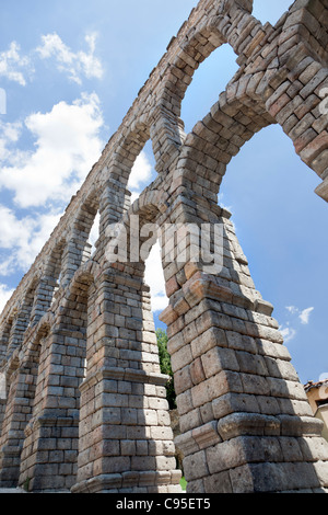 The Roman Aqueduct of Segovia, Spain. towering an amazing 28.5 meters (93.5 feet) over the small village below. - Stock Photo