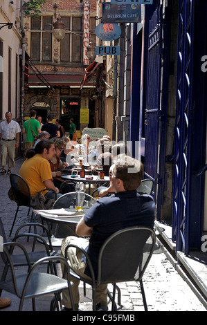 People sit outside at tables at the Delirium Tremens Pub, in Brussels, Belgium - Stock Photo