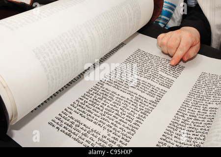 Boy reads the Torah for his Bar Mitzvah at the Wailing Wall in Jerusalem, Israel - Stock Photo