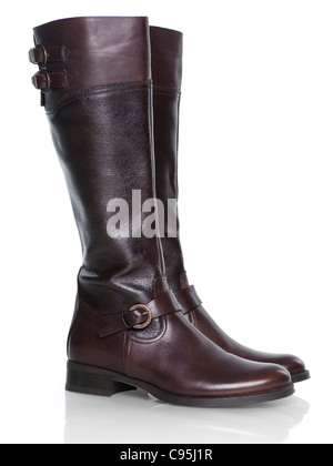 Knee-high brown leather fashion womens boots isolated on white background - Stock Photo
