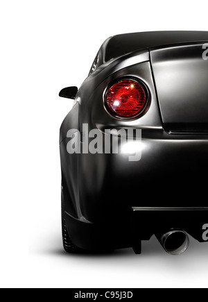 Closeup of a mat black exotic custom car back with a tail light. Isolated on white background. - Stock Photo