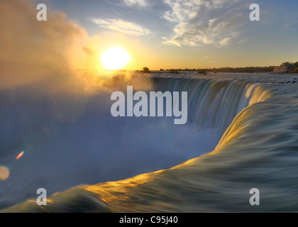 Brink of Niagara Falls Canadian Horseshoe during sunrise. Niagara Falls Ontario Canada. - Stock Photo