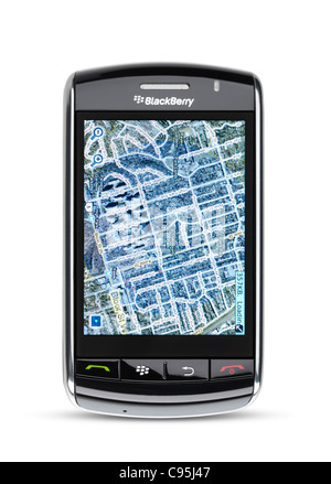 Blackberry Storm 9530 touch screen smartphone with Google Maps GPS on illuminated display isolated on white background - Stock Photo