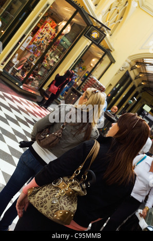 Women browsing shops in the historic Royal Arcade.  Melbourne, Victoria, Australia - Stock Photo