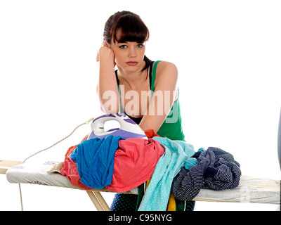 Young Woman Ironing. Model Released - Stock Photo