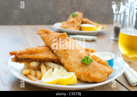 Fried fish fillets with chips - Stock Photo