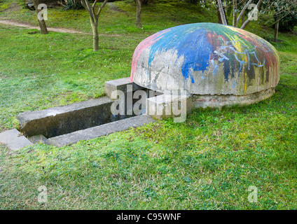 Defensive bunker or bomb shelter, Tirana, Albania.  Thousands of bunkers were built during the rule of Enver Hoxha. - Stock Photo
