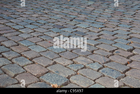 Grey cobbled pavement, background texture. - Stock Photo