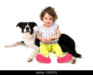 Toddler and her pet dog. - Stock Photo