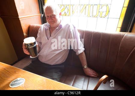 Republic of Ireland, Elderly Man Drinking Guinness - Stock Photo