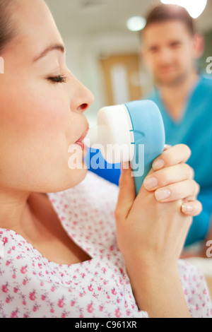 Childbirth. Pregnant woman taking gas and air during childbirth. - Stock Photo