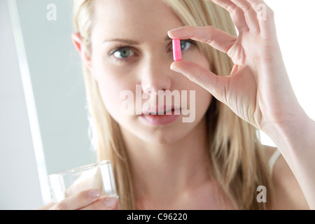Taking a pill. - Stock Photo