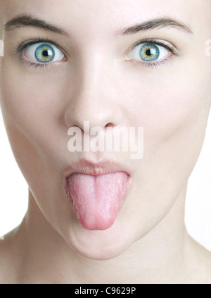 Woman sticking her tongue out. - Stock Photo