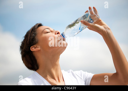 woman drinking bottled water stock photo royalty free