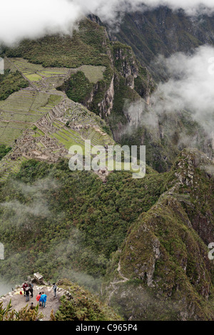 Machu Picchu, the most known tourist site in Andes mountains, Peru, seen from Wayna Picchu mountain top. - Stock Photo