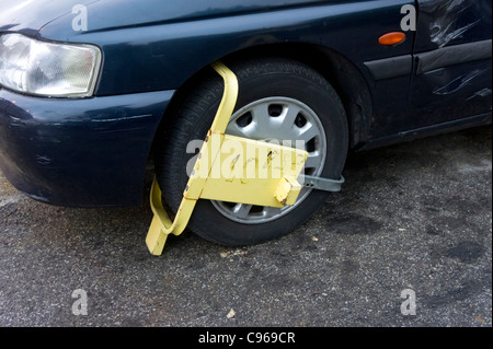 Wheel clamp on car - Stock Photo