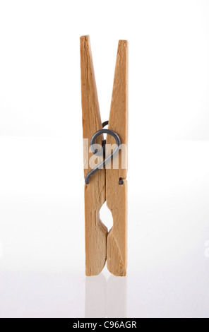 Clothes peg isolated with its reflection on white background. Included clipping path, so you can easily cut it out - Stock Photo