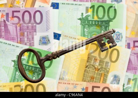 Many Euro banknotes with key - Stock Photo