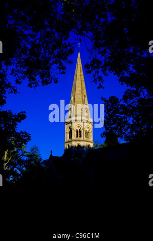 High contrast Ranmore Church spiral in summer time dusk with trees framed the and shadow of the church against deep - Stock Photo
