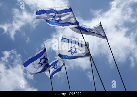 Israeli flags in the sky - Stock Photo