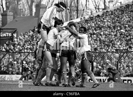 Everton V Luton Town FA Cup semi final at Villa Park 13/4/85 Steve Foster jumps on his colleagues to celebrate - Stock Photo