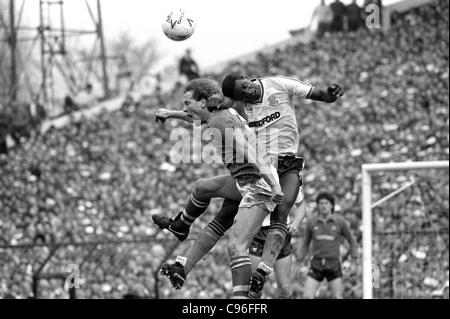 Everton V Luton Town FA Cup semi final at Villa Park 13/4/85 Villa's Andy Gray and Luton defender Mitchell Thomas. - Stock Photo