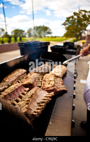Grilling ribs on the barbecue - Stock Photo