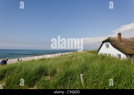 Thatched-roof house on the beach of Ahrenshoop, Fischland-Darss-Zingst peninsula, Baltic Sea, Germany - Stock Photo