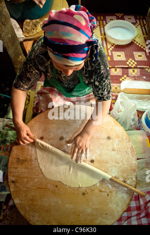 Turkish woman making Gozleme - Stock Photo
