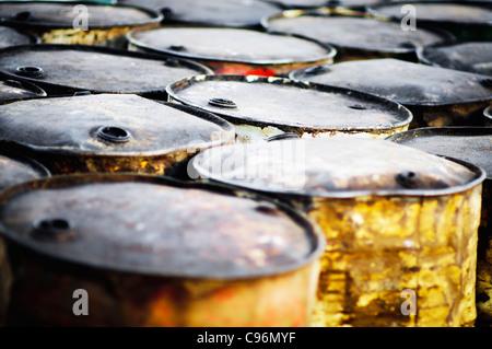rusty oil barrels on beach - Stock Photo