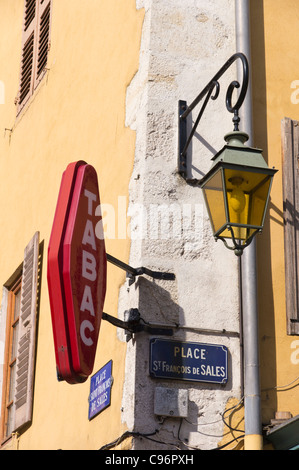 Tabac sign above a tobacconist shop on the corner of a street in Annecy old town - Stock Photo