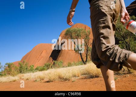 Hiker on the Uluru (Ayers Rock) Base Walk.  Uluru-Kata Tjuta National Park, Northern Territory, Australia - Stock Photo