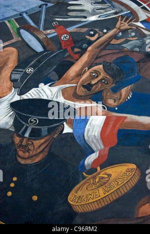 detail of the cable street mural marking the 1936 attempt  by the british union of fascists to march through london's - Stock Photo