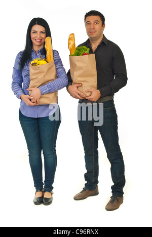 Full length of couple holding paper shopping bags with food isolated on white background - Stock Photo