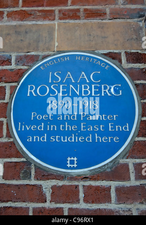 english heritage blue plaque commemorating poet and painter isaac rosenberg and his links with london's east end - Stock Photo