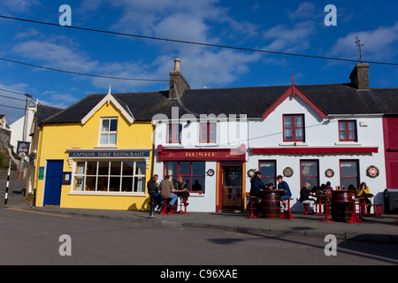 People outside Bushe's Bar in The fishing village of Baltimore, West Cork, Ireland - Stock Photo